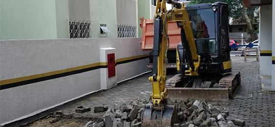 pavimentação paver escavadeira